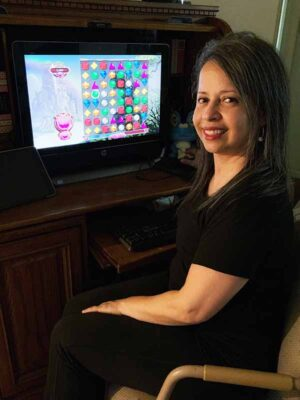 Betty Morales at her computer
