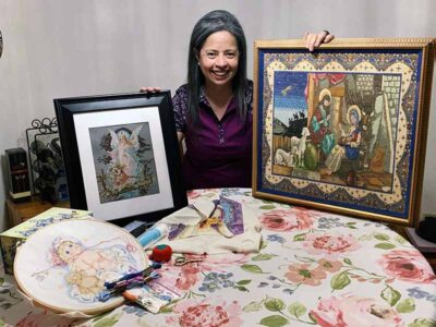 Betty Morales with her paintings