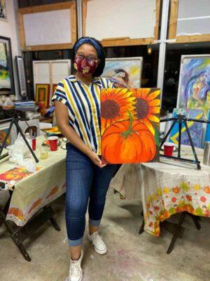 Elisabeth Dubois with a sunflower painting