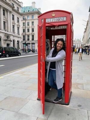 Elisabeth Dubois a red phone booth in London