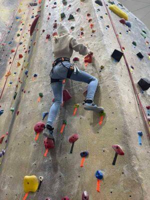 Jackie Rodriguez climbing a rock